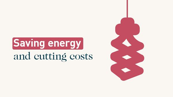 Energy saving light bulb. Text: Saving energy and cutting costs